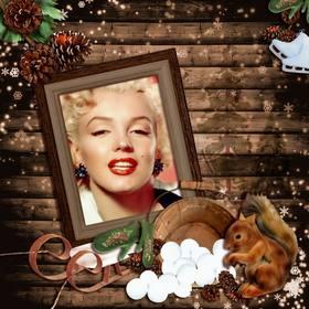Fotomontage des Winters mit einem hölzernen Bilderrahmen mit einem Schlitten, ein Eichhörnchen und einige Kegel eingerichtet.